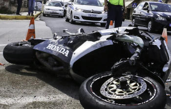 the motorcycle is lying on the street after the accident