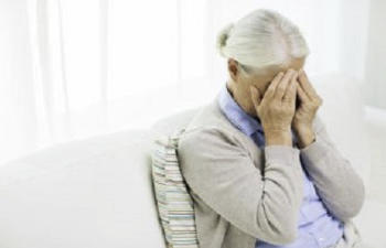 distraught elderly woman