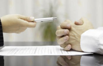 the person gives the person a pen to sign the contract
